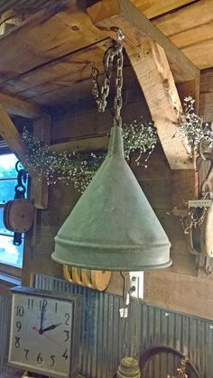 Waste not, want not is the mantra at Grain Bin Antique Town, where this farmer's funnel was recycled to create a one-of-a-kind lamp. Silo House, Grain Silo, Stock Tank, A Frame House, Antique Decor, Nebraska, Romantic Getaway, Repurposed, Grains