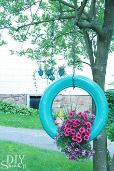 Did you ever think an old tire could look so pretty? All you need is spray paint, a chain, and a hook to make this surprisingly lovely planter. Get the tutorial at DIY Show Off.  RELATED: 21 Ideas That Will Beautify Your Yard (Without Breaking the Bank)   - CountryLiving.com
