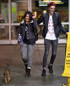 Puppy love! Shenae Grimes and her husband Josh Beech couldn't stop smiling as they landed ...