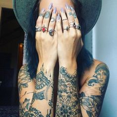 Love the mandala designs on her wrists