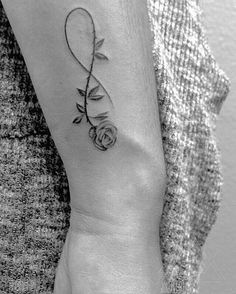lines on this black and grey Rose infinity symbol. Jordan Busbea @ Propaganda Tattoo Parlor in San Diego - -Clean lines on this black and grey Rose infinity symbol. Jordan Busbea @ Propaganda Tattoo Parlor in San Diego - - Infinity rose Vine Tattoos, Feather Tattoos, Wrist Tattoos, Flower Tattoos, Body Art Tattoos, Butterfly Tattoos, Tatoos, Infinity Tattoo With Feather, Infinity Tattoo Designs