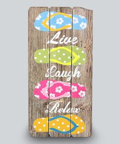 Bring a touch of tropical relaxation to your room with this distressed wall sign sporting a slew of fun flip flops.