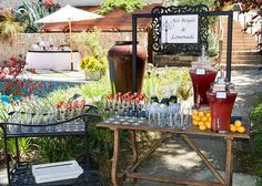 A lemonade & cocktail stand to welcome guests. Yes please!