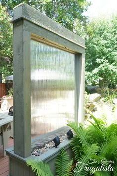 DIY Water Wall backlit with Solar Spotlights   The Interior Frugalista