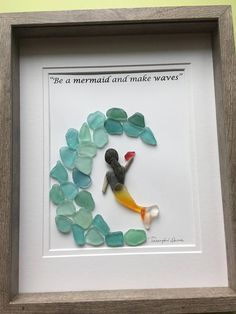 """Mermaid "" pebble art is a lovely handcrafted piece framed by me in 11x14 grey shadow box as shown.This is ideal Gift perhaps for a Nature Lover or Just Because simply to decorate your home as a talking point. Made of geniune blue sea glass and pebbles. Thanks for your interest!"