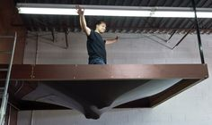 Alex, one of our friendly installers, demonstrates how strong stretched ceilings are!  http://blog.laqfoil.com/?p=715