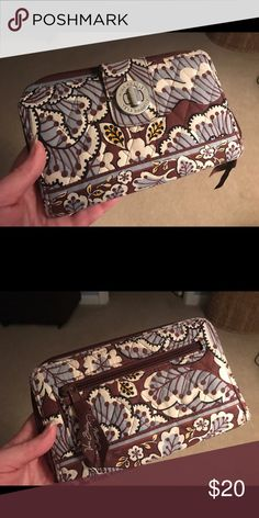 Discontinued Vera Bradly, Slate Blooms pattern Large Vera Bradly wallet from the discontinued Slate Blooms pattern. Very gently used. In very good shape. Cash/local pickup only Vera Bradley Bags Wallets
