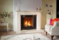 DRU Global gas fires offer all the benefits of a quality DRU fires, but at a prices that are affordable for the average household. Gas Fires And Surrounds, Fireplace Surrounds, Condo Living Room, Living Room With Fireplace, Living Rooms, Log Effect Gas Fires, Glass Fronted Gas Fire, Fireplace Gallery, Fireplace Ideas