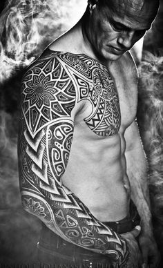 powerful tribal sleeve tattoo