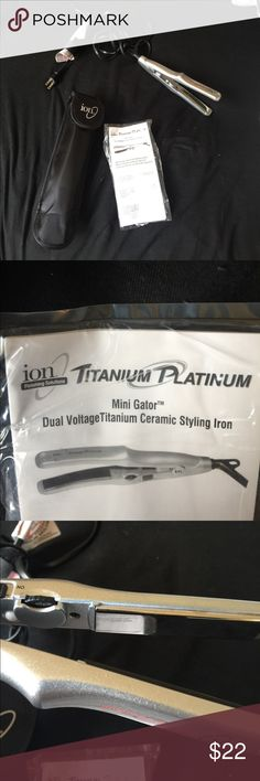 ION TITANIUM PLATINUM MINI GLADIATOR FLAT IRON This is brand new, I did take it out of the box to use but I ended up using my bigger flat iron instead. This amazing MINI GLADIATOR CERAMIC STYLING IRON comes with a traveling case as shown above in the photos.!!! ION Accessories