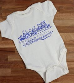 Philadelphias Boathouse Row on the Schuykill River, drawn, labeled + screenprinted onto an organic cotton baby one piece.    This listing is for a