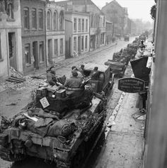 Sherman tanks, carriers and other vehicles in Geldern, 6 March 1945.