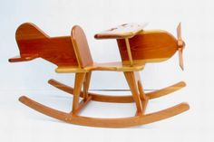 Rocking Airplane by dragonwooddesigns on Etsy. If only this had one less zero. Wooden Projects, Wood Crafts, Wooden Airplane, Wood Toys, Diy Toys, Rocking Chair, Rocking Horses, Kids Furniture, Diy For Kids