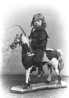 1905 Boy and toy horse.