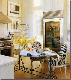I would have never thought that these animal print chairs could work in a kitchen, but they totally do!