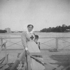 Grand Duchess Olga Alexandrovna in Red Cross nurses uniform and her nephew