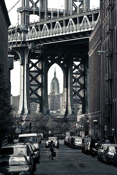 Manhattan Bridge frames the Empire State Building, Brooklyn, New York