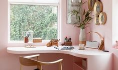 The blush-pink corner desk and walls