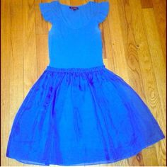 Blue Betsey Johnson Dress Super cute Betsey dress with pockets. Fully lined and nice thick material., sheer overlay and capped sleeves! There is some slight discoloration near the armpits which is not noticeable when worn (can be seen in pic #4, noticeable in pic because of the flash) Betsey Johnson Dresses