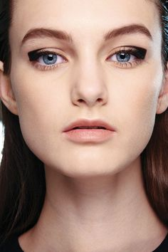 """AQUASCUTUM – """"Gorgeous, geometric coolness"""" was how Lucia Pieroni described the squared-off eyes at Aquascutum, which offered a modern take on the cat-like eye. Photo By MAC Cosmetics"""