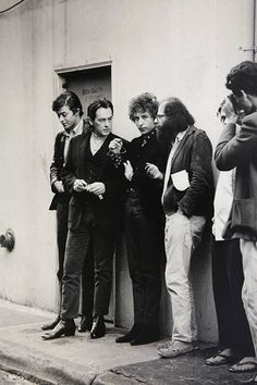 Beat poets Michael McClure, Allen Ginsberg & Bob Dylan outside a bookstore in Frisco 1965 Photographer
