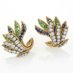 Van Cleef & Arpels Mid-20th Century Jeweled and Gold Earrings.  Available exclusively at Macklowe Gallery.