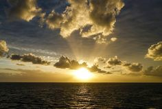 Sticking with the sun vibes throwback to this cloudy sunset from my last night on the Great Barrier Reef. It was winter and I was in the middle of the sea but still able to kickback with a cold beer and watch the day draw to a close #Sunset #Throwback #Dusk #Day #Night #Seascape #Sea #Ocean #Travel #Instatravel #GreatBarrierReef #Cairns #Queensland #EastCoast #Water #Australia #Boat #Sky #Clouds #Sun #Landscape #BoatLife #Reef #Coral #CoralReef #CoralSea by timothyjcannon…
