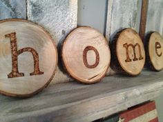 Rustic HOME sign wood burned into a rustic log... Www.rusticwoodhomedesign.com Rustic HOME sign with letters applied using a wood burning tool. The wood is cut from a rustic looking log. When I came up with the design I wanted it to look as natural as possible so a light stain is applied but I really wanted the natural look.   Add a simply rustic look to any room and to any home style. This is a very versatile piece and may be the future Mrs. favorite that I have made to date.