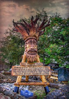 """The poem on the board is in swiss german and says :   I am the mountain troll """"Alps Land""""   Welcome here on Brestenegg, it comes from the heart.  It is beautiful up here, as you can be without sorrow and pain.  And you can marvel, and enjoy the beautiful alps world.  This gives you satisfaction and patriotism for little money.  -  Photo by Hanny Heim, Snowbird Photography #photography   #switzerland   #schweiz   #berggeist   #wood    #holz   #emmental   #brestenegg"""