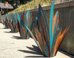 This massive blue tequila agave will catch the eye of any passerby. It stands at 4 feet tall made of steel with flares of blue contrasting with the rusty patina. These are 100% handmade to order in the USA and will vary in patinas and shape a bit from plant to plant so every plant is unique.
