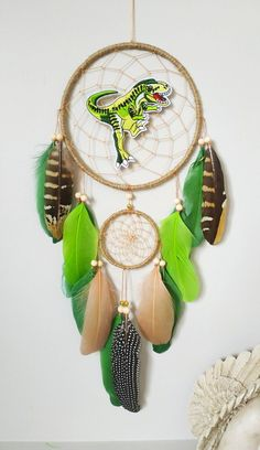 T rex dinosaur decor nursery dream catcher baby boy gift, dreamcatcher dinosaur birthday Hang this lovely dream catcher to catch bad dreams while you sleep or bring good vibes into your space. Made with attention and love this dream catcher brings its owners good dreams and positive energy. Dinosaur Room Decor, Dream Catcher Decor, Pheasant Feathers, Bad Dreams, Dinosaur Birthday, Hand Wrap, Baby Boy Gifts, T Rex, Gold Beads