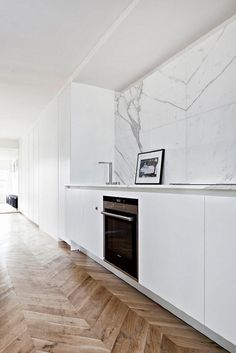 Beautiful wooden flooring matched a stunning featured marble wall #furniturehunters | vosgesparis paris apartment2