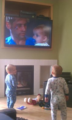 Jaxon and Jakob watching themselves on t.v.