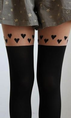 hearts stocking - all these photoshopped thigh gaps are killing me. XD I've never seen straight lines on a human body before...