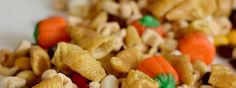 Thanksgiving Snack Mix - Alphabits cereal, Cone shaped Corn Chips, chocolate coated candies, candy pumpkins and fruit trail mix.