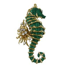 Wander malachite Seahorse  France  1970's  Impressive Malachite and 18 karat gold Seahorse. Over 3 inches long. 1 carat of gorgeous bright diamonds.
