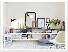 love the white wood floor and the long low shelves...