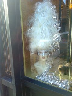 giz looking in window at hairdressers abbeyville road not to sure
