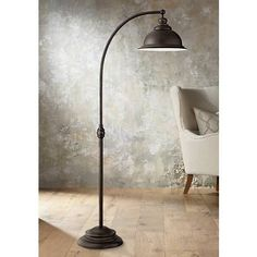 This arc lamp features a timeless profile that will add extra lighting for reading or entertaining.