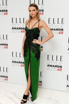 Even the star's styling was more vampy than usual, with side-slicked hair, winged eye makeup and dark nail polish adding a more sexy, grown-up look than we have come to expect from Swift. Description from hollywoodreporter.com. I searched for this on bing.com/images