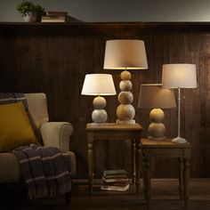 Choose natural wood designs like these table lamps from John Lewis, to create the perfect cosy setting at home