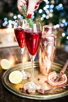 The most delicious and festive looking this Pomegranate French 75 made with gin, pomegranate juice and champagne will wow your guests this holiday season!