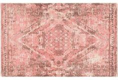 Love the antique look of this dusty pink Persian-inspired area rug.