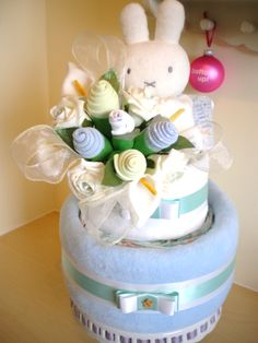 Blue 2 tier nappy cake with clothing bouquet and large Miffy plush.