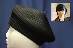 Phryne's beret is a classic French beret made in a circular manner and forms part of her 'cat-burglar' ensemble in 'Murder Most Scandalous' (Series 2, Episode 1)