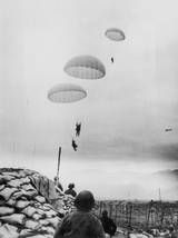 French paratroopers drop in to the valley at Dien Bien Phu during the First Indochina War, March 23, 1954.