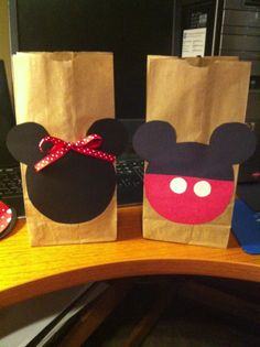 Minnie Mouse themed candy goody bags! Homemade with construction paper and brown bags!