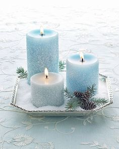Frosty Winter Pillar Candles - Basic Epsom salts give these blue candles an icy charm. Turn them into Christmas centerpieces with pinecones and bits of winter greenery. Noel Christmas, All Things Christmas, Winter Christmas, Christmas Wedding, Xmas, Christmas Candles, Christmas Countdown, Christmas Ideas, Frozen Christmas