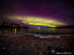 Aurora over Mill Bay in Kodiak, Alaska. This beach is a hot spot for catching the northern lights. Image by Melissa Baines graphic design and photography out of Mobile, AL