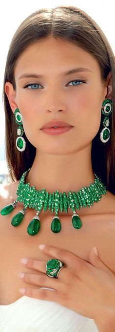 Bianca Balti wearing a diamond and emerald necklace, earrings and ring by De Grisogono